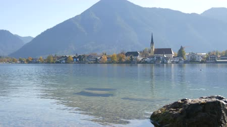 bajor : Beautiful old church in vibrant place on the background of the Bavarian Alps on the shore of Lake Tegernsee