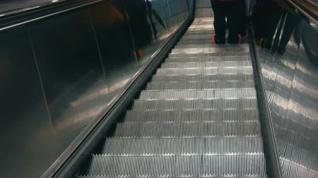hurry up : Large modern staircase escalator rides the subway down Stock Footage