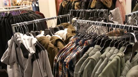 šatník : Nuremberg, Germany - December 3, 2018: Mens fashionable and stylish clothes on hangers in a clothing store in a mall