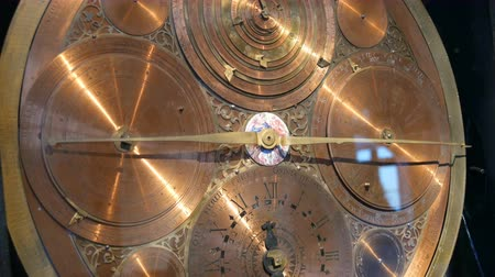 заводной : Ancient astronomical clocks near view. Latin inscriptions