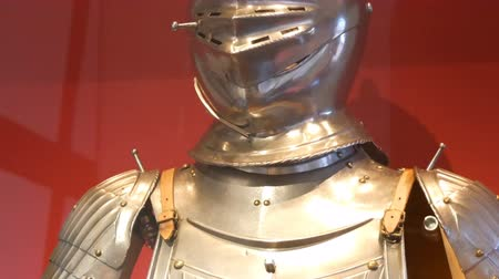 cavaleiro : Medieval iron knight armor as an exhibit in the museum at the castle.