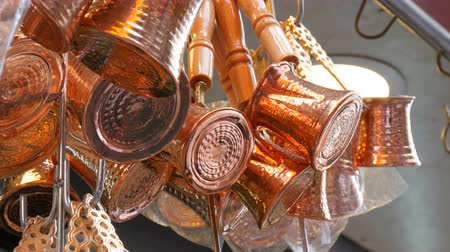 drawer : Beautiful shiny copper coffee turks hang in Istanbul market