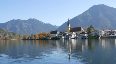 bavorské : Beautiful view of the Tegernsee lake in Bavarian Alps. Old church by the lake and mountains Dostupné videozáznamy