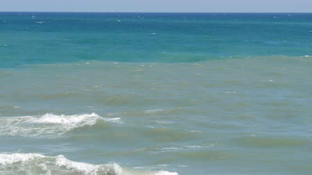 регионы : Beautiful tricolor sea with different shades of turquoise blue and dark green with waves and white foam on it Стоковые видеозаписи