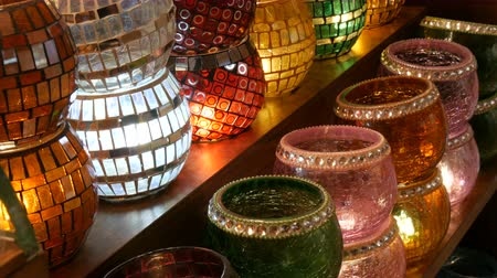 antiquario : Many colorful Turkish lamps in a store on GrandBazar, Istanbul, Turkey. Traditional Colorful Handmade Asian Mosaic Lanterns of Colored Glass on Market. Arabic lamps Filmati Stock
