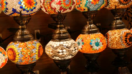 ramadan bazaar : Many colorful Turkish lamps in a store on GrandBazar, Istanbul, Turkey. Traditional Colorful Handmade Asian Mosaic Lanterns of Colored Glass on Market. Arabic lamps Stock Footage