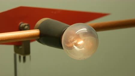 pulling off : Experiment with electricity and electric incandescent lamp or light bulb and magnetic fields Stock Footage