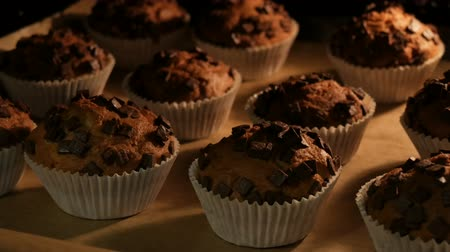 pastelaria : Delicious muffins in paper molds are cooked in oven close up view