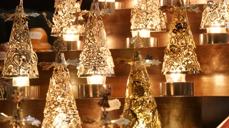 kaligrafia : Beautiful cozy luminous Christmas candlesticks lights on market counter Wideo