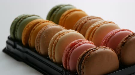 pastelaria : Multicolored french cookies macaron in a special black box on a white table. Colorful cake macaroon in a gift box