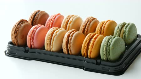 speciality : Multicolored macaron or macaroon on a white table