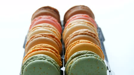 pastelaria : Multicolored french cookies macaron in a special black box on white table