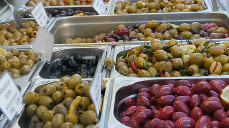izrael : Market counter with various stuffed olives of green, red, black. Vegetarian food