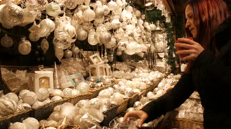 winter palace : Vienna, Austria - December 21, 2019: White Glass Christmas toys and decorations balls on counter of Christmas market. Night shot Vienna christmas market