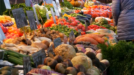 Vegetable and fruit market with huge assortment of diverse fruits. Healthy Vegetarian Food. Vegetable market in big city. Healthy fresh organic vegan food on the counter. Price tags in German.