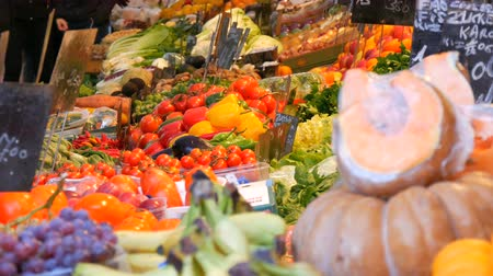 stragan : Vegetable and fruit market with huge assortment of diverse fruits. Healthy Vegetarian Food. Vegetable market in big city. Healthy fresh organic vegan food on the counter. Price tags in German.