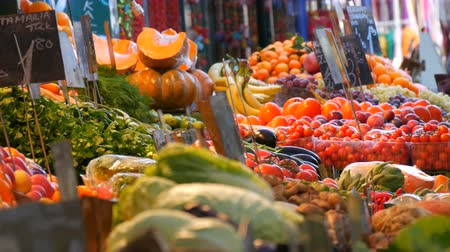 Vegetable market in a big city. Huge selection of various vegetables and fruits. Healthy fresh organic vegan food on the counter. Price tags in German. Dostupné videozáznamy