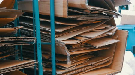 hajtogatott : Cardboard boxes folded for further processing. Garbage sorting, environmental protection