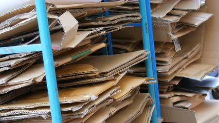 газета : Cardboard boxes folded for further processing. Garbage sorting, environmental protection