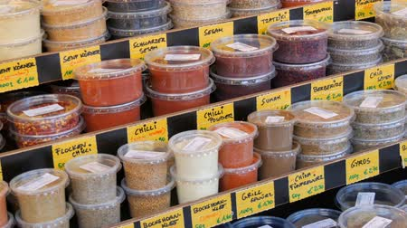 saffraan : Various spices on a market counter. Cilantro, hot peppers, sweet peppers, saffron, turmeric, oregano, thyme hop and more. Vienna, Austria. German price tags Stockvideo