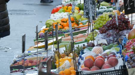 roma : Vegetable and fruit market with huge assortment of diverse fruits. Healthy Vegetarian Food. Vegetable market in big city. Healthy fresh organic vegan food on the counter. Price tags in German.