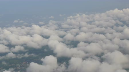 кучево дождевые облака : The plane flies over the Dutch cities, the green fields of multicolored tulips. Holland from above in clouds
