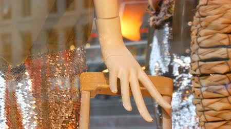 schaufensterpuppe : Part of a womans mannequin hand and suitcase handle. Dummy in shop window. Beautiful, expensive, fashionable clothes are shown on a boutique showcase