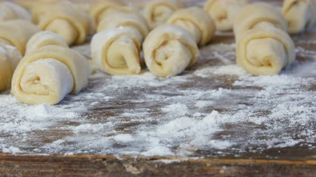 pasta cutter : Raw croissants in a row. Homemade sweet pastries. Jam, the dough at home kitchen. Female hand takes one croissant