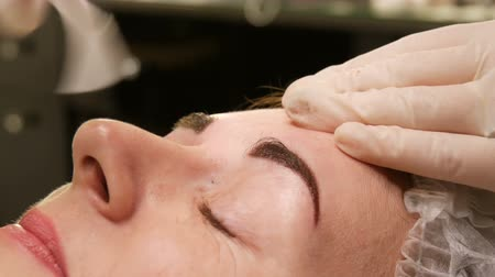 tweezing : Eyebrow Waxing. The Special procedure after permanent dyeing of eyebrows. Microblading