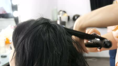 barber equipment : Special hot iron for curling hair curls. Beauty and fashion concept. Stylist Using Tool for Modeling