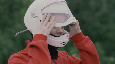 Portrait young woman in protective helmet slow motion. Girl in helmet on head