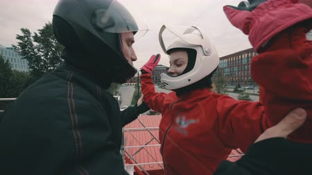 Male coach instructs a skydiver girl before flying into wind tunnel Stock mozgókép