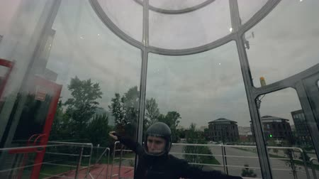 Professional skydiver flies in wind tunnel. Indoor skydiving tunnel