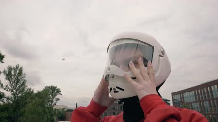 Portrait young woman in protective helmet for extreme sport slow motion