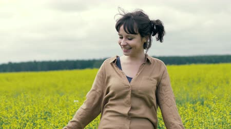 Portrait happy young woman on a summer walk in field Stock mozgókép