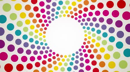 színek : Abstract background with colorful rotating polka dots endless loop Stock mozgókép