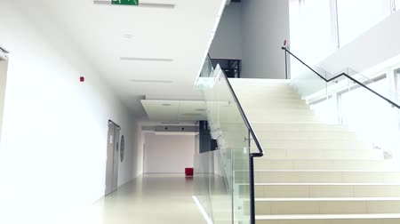 entrance : look at the bright modern building interior stairs and hallway Stock Footage
