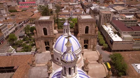 ima : Cuenca, Ecuador  Oct 27, 2017 - Drone flies over famous domes of the New Cathedral. Construction crews can be seen starting renovation of the church.