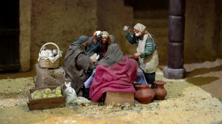 jesus born : Cuenca, Ecuador - January 3, 2019 - Largest animated nativity scene in South America. Men congregate around table. Stock Footage