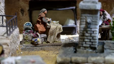 moudrý : Cuenca, Ecuador - January 3, 2019 - Largest animated nativity scene in South America. Woman irons clothes. Dostupné videozáznamy