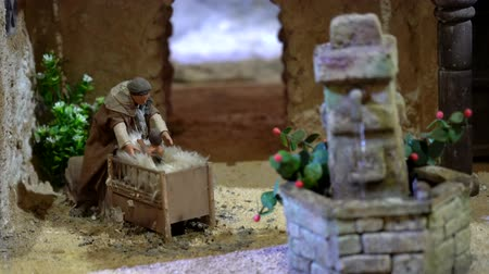 jesus born : Cuenca, Ecuador - January 3, 2019 - Largest animated nativity scene in South America. Woman picks baby up out of crib.