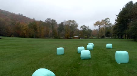 hay fields : Aerial Drone - Fly Low Over Plastic Wrapped Bales of Hay in Fall in Vermont.