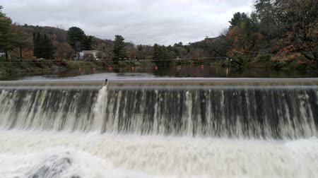 rock wall : Aerial Drone - Fly Over Artificial Spillway Near Waitsfield Covered Bridge in Vermont