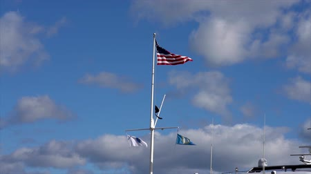 glória : Slow Motion-American Flag Flies in Breeze Above Three Maritime Flags Vídeos