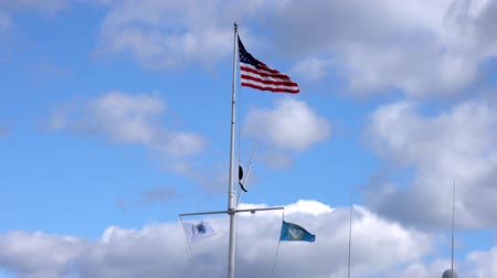marítimo : American Flag Flies in Breeze Above Three Maritime Flags