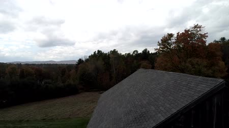 barnyard : Aerial Drone - Rise Up From Foot of Old Barn to Expose Vibrant Colored Trees in Fall in Vermont 4K Stock Footage
