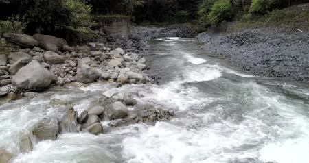 upstream : Banos, Ecuador - September 24, 2018 - Drone Follows White Water of River at Low Altitude Stock Footage