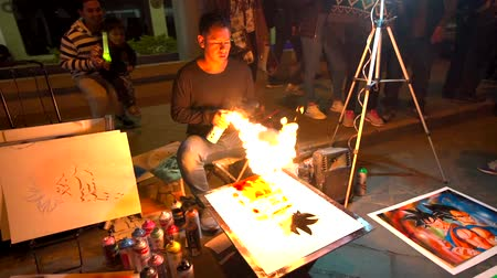 kutuları : Cuenca, Ecuador  -  20180602  -  Spray Paint Artists  -  Slow Motion  -  Artist Picks Up Spray Can And Lights Fire Stok Video