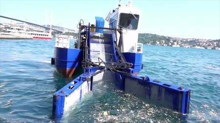 kolektor : Istanbul, Turkey - May 30, 2016 - Garbage Collecting Boat on Bosphorus Straight Heading Towards Camera