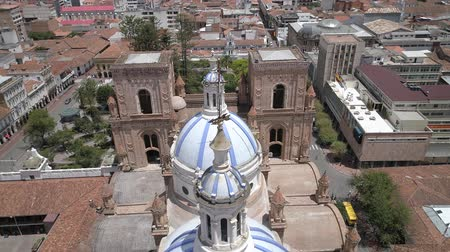 god ray : Cuenca, Ecuador - Oct 27, 2017 - Drone flies over famous domes of the New Cathedral. Construction crews can be seen starting renovation of the church.